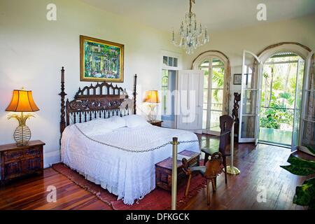 Bedroom, Ernest Hemingway home and museum  Key West  Florida, USA - Stock Photo
