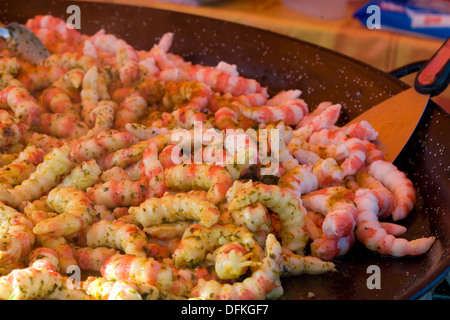 saute of prawns with loads of parsley and garlic cooking in Frying Pan - Stock Photo