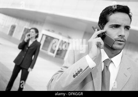 Executives talking on cellular phone - Stock Photo