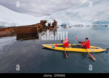 Guests from the Lindblad Expedition ship National Geographic Explorer enjoy the Enterprise Islands in Antarctica - Stock Photo