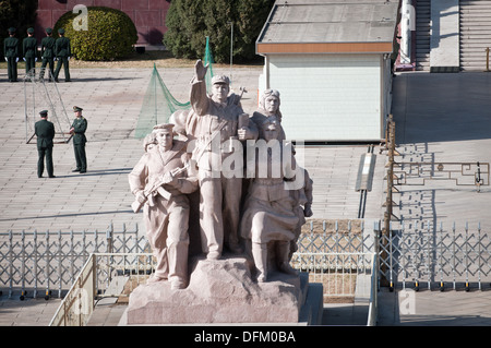 One of the revolutionary statues located near the entrance of the Chairman Mao Memorial Hall (Mausoleum of Mao Zedong) - Stock Photo