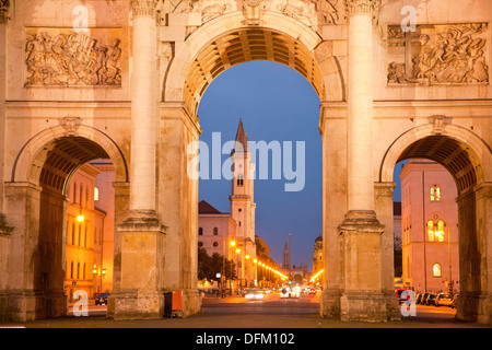 The Siegestor ( Victory Gate) and St. Ludwig church in Munich, Bavaria, Germany - Stock Photo