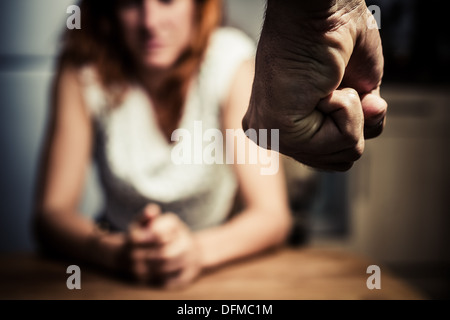 Close up on a man's fist with a woman in the background - Stock Photo