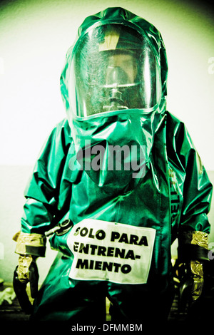 Global chemical warfare, conceptual artwork. Human in a chemical protection - Stock Photo