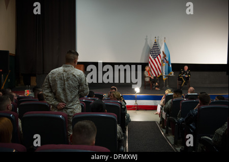 A U.S. Marine asks a question during a town hall with the Chairman of the Joint Chiefs of Staff Gen. Martin E. Dempsey - Stock Photo
