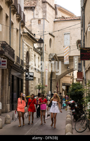 young women walk through narrow street in city center of Old Montpellier; Montpellier; Herault; Languedoc; Roussillon; - Stock Photo
