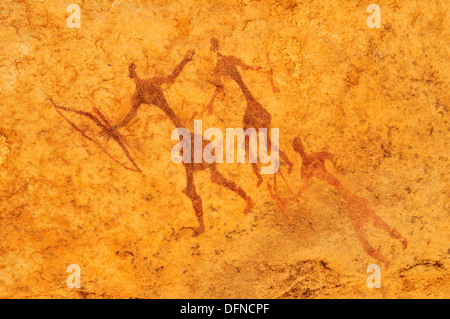painted warriors or hunters, neolithic rockart at Tin Meskis, Adrar n´ Ahnet, Algeria, Sahara, North Africa - Stock Photo