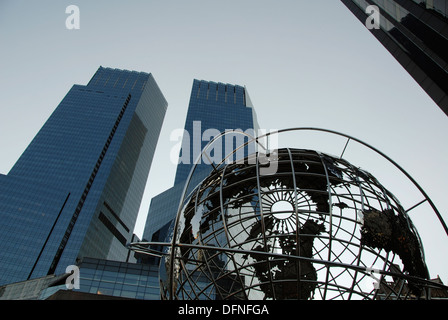 The Time Warner Center mixed use twin towers and Globe sculpture in front of the Trump International Hotel and Tower. - Stock Photo