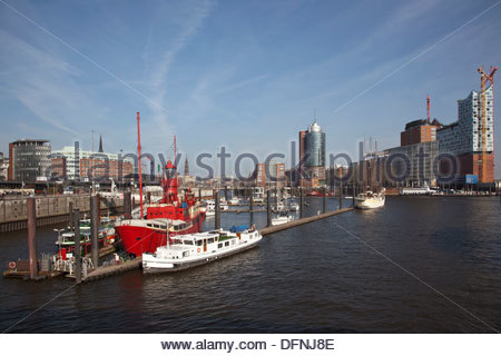 Lightvessel, lightship in Hafen-City with Elbe Philharmonic Hall, Elbphilharmonie in the background, Hamburg, Germany - Stock Photo