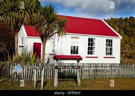 Historic schol house now a youth hostel, Okarito lagoon, West Coast New Zealand - Stock Photo