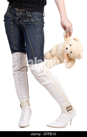 Woman taking a teddy bear in her hand. Isolated on white - Stock Photo
