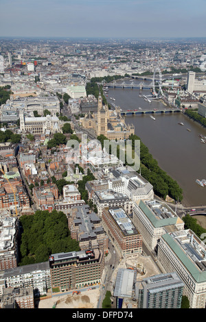 aerial view up Millbank in Westminster towards the Houses of Parliament and London Eye, London SW1 - Stock Photo