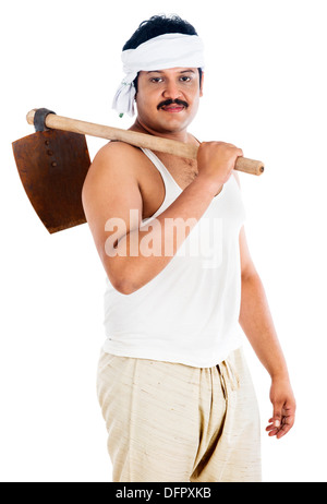 Portrait of a farmer carrying spade on his shoulders - Stock Photo