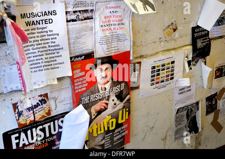 London, England, UK. Posters and adverts stuck to a wall (legible contact details changed or obscured) - Stock Photo