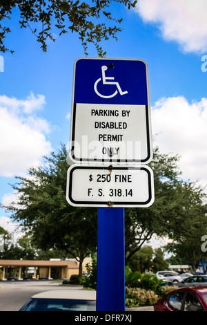 Official parking for disabled motorists in a shopping plaza car park - Stock Photo