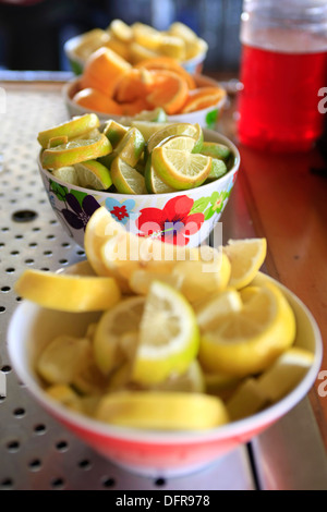 Fresh Citrus fruits sit in china bowls - Stock Photo