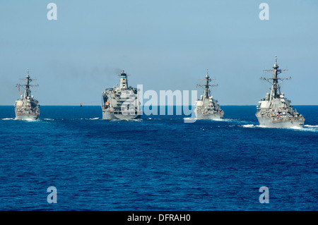 Arleigh Burke-class guided-missile destroyers USS Ramage (DDG 61), USS Barry (DDG 52) and USS Stout (DDG 55) conduct - Stock Photo