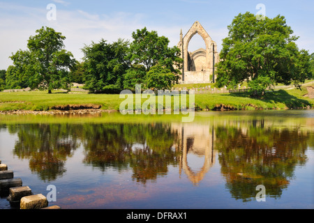 The ruins of Bolton Priory reflected in the River Wharfe, Bolton Abbey, Yorkshire Dales National Park, England - Stock Photo