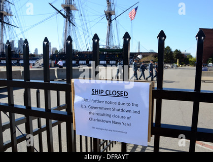 A closed notice posted at the front gate of USS Constitution in Charlestown Navy Yard. Constitution and the yard - Stock Photo