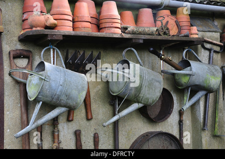 Garden tools tidily stored and stacked UK - Stock Photo