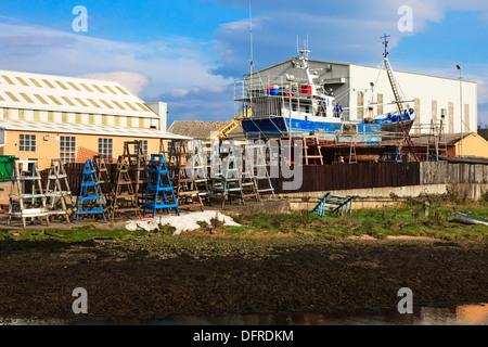 Fishing trawler in dry dock being repaired at the shipbuilders yard, Girvan, Ayrshire, Scotland, UK - Stock Photo