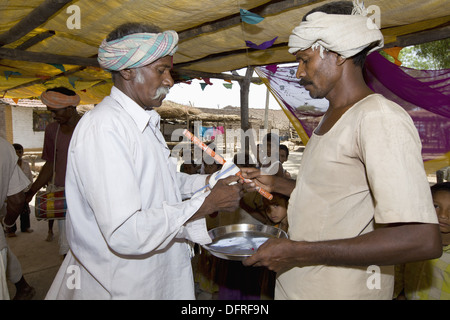 Musicians in marriage ceremony of Korku Tribe, Khalwa, Jharikheda village, Madhya Pradesh, India. - Stock Photo