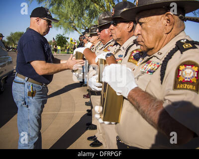 Phoenix, Arizona, USA. 8th Oct, 2013. Members of Veterans Of Foreign Wars honor guard unit hold urns containing - Stock Photo