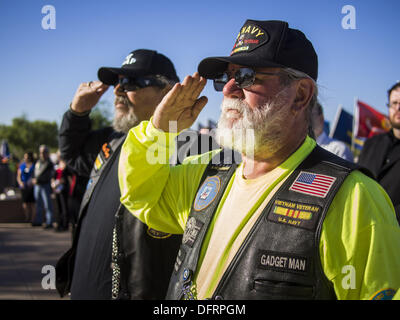 Phoenix, Arizona, USA. 8th Oct, 2013. US military veterans salute at a ceremony interring the cremated remains of - Stock Photo