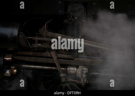 Pistons, steam and steal that drive the wheels of this steam engine at Blue Bell Railway. - Stock Photo