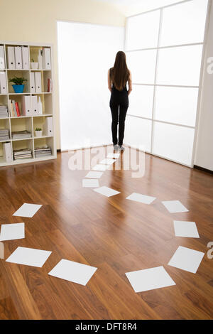 business woman standing behind the shape of question mark - Stock Photo