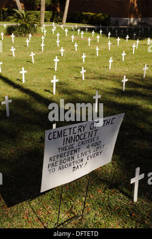 Crosses and sign on church lawn represent abortions performed - Stock Photo