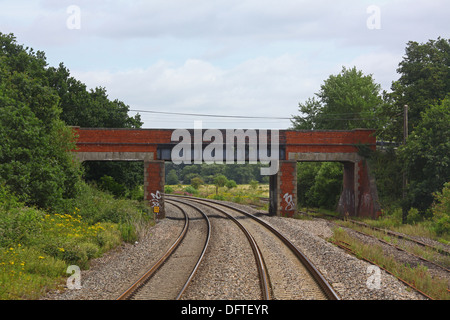Approaching Padworth road Bridge on the Berks and Hants line looking towards Reading showing an old brick built - Stock Photo