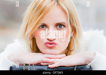 Young woman is kissing - Stock Photo
