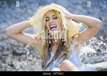 Happy in water young woman - Stock Photo