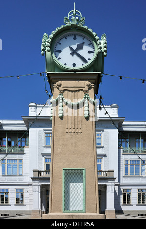 Large Viennese Art Nouveau standing clock, built around 1900 according to a design by Otto Wagner, in front of the - Stock Photo