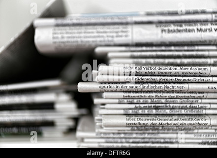Stack of newspapers, Germany - Stock Photo