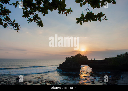 Temple of the Tanah Lot temple complex on the south coast at sunset, Tanah Lot, Bali, Indonesia - Stock Photo