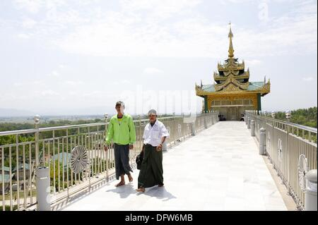 Burmese pilgrims entering at the Uppatasanti Pagoda, a main religios attraction in Naypyitaw  The pagoda host a - Stock Photo