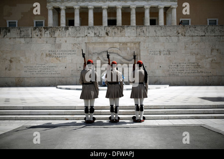 Evzones perform the Changing of the guard ceremony at the Tomb of the Unknown Soldier in Syntagma Square in Athens, - Stock Photo