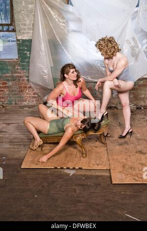 Dancers posing in an old factory - Stock Photo