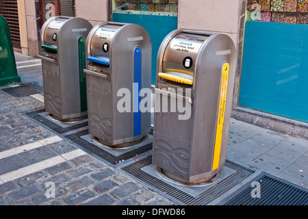 Recycling bins in the Old Town of Pamplona, Spain, route the refuse to underground collection points - Stock Photo