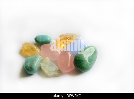 Group of color semi-precious gemstones such as citrine, aventurine, moonstone, rose quartz and blue calcite on white - Stock Photo