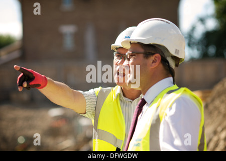 men on a construction site - Stock Photo