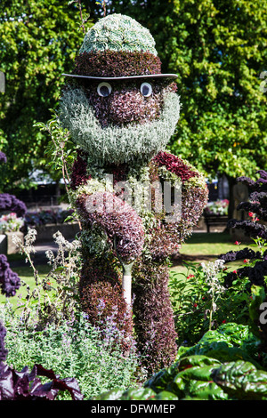 Horticultural sculpture depicting Bayleaf the Gardener from the children's TV show 'The Herbs' in the Parade Gardens, - Stock Photo
