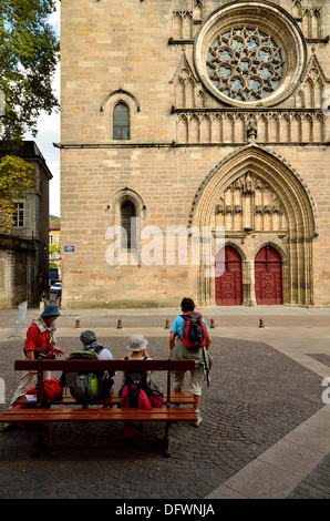 Pilgrims on The Way of St James  resting outside the Cathederal of Saint-Etienne in Cahors - Stock Photo