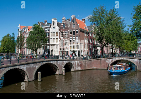 Keizersgracht Amsterdam Netherlands canal house city town boat - Stock Photo