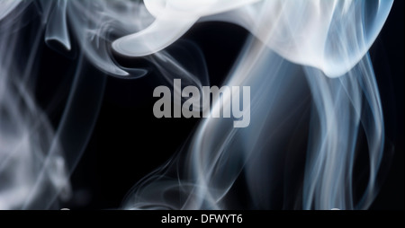 Abstract of smoke against black background - Stock Photo