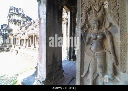 The corridor near apsara Relief statue in Cambodia Angkor Wat, Cambodia - Stock Photo