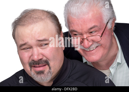 Older man got in to personal space of a younger man. Younger man showing his emotions with unpleasant face - Stock Photo