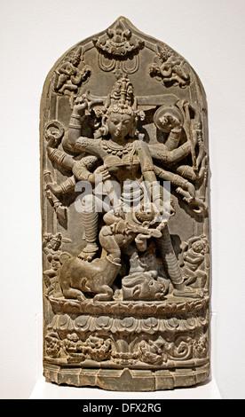 Durga ( Hindu goddess ) killing the buffalo demon 11th century stone Pala style Bangladesh Museum sculpture statue - Stock Photo